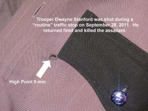 Trooper Dwayne Stanford's bulletproof vest saved him from death by gunfire.