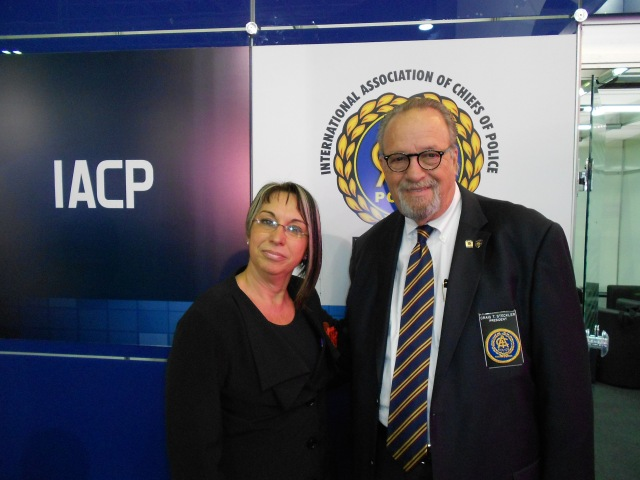Brazilian National Secretary for Public Safety Regina Miki, and IACP President Craig Steckler take a break between meetings at the 11th IACP South American Executive Policing Conference for a photo.