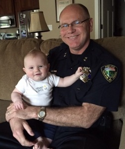 """I wear my badge as a reminder of my responsibility to provide a safe community and to protect the innocent. My grandson reminds me too of that too."" - Chief Kent Barker, IACP Vice President at Large"